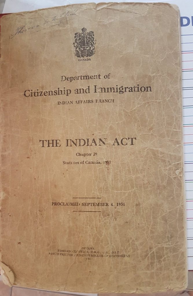 """A yellowed copy of The Indian Act. On the cover: """"Department of Citizenship and Immigration. Indian Affairs Branch. The Indian Act, Chapter 29."""" Photograph courtesy of @LawladyINM"""